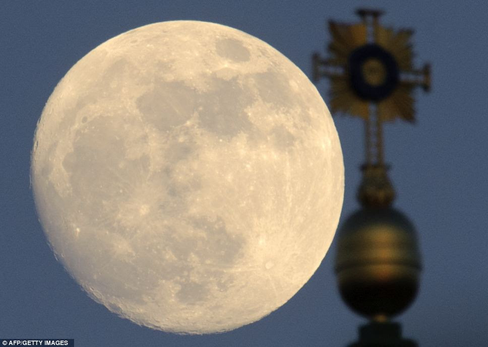 Clear as day: Even before night fell over Dresden, eastern Germany, the moon was looking incredible behind the Church of Our Lady