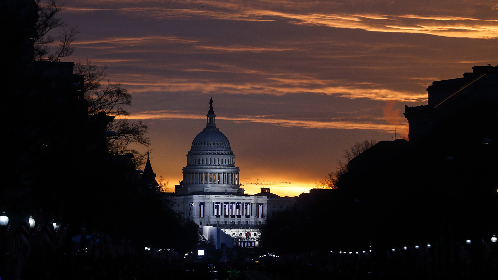 The Capitol Building is illuminated against the sunrise before the presidential inauguration of President-elect Donald Trump, Friday, Jan. 20, 2017, in Washington. (AP Photo/John Minchillo)