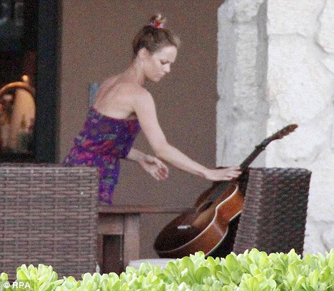 Hawaii break: Singer Vanessa puts a guitar down; she plays the instrument