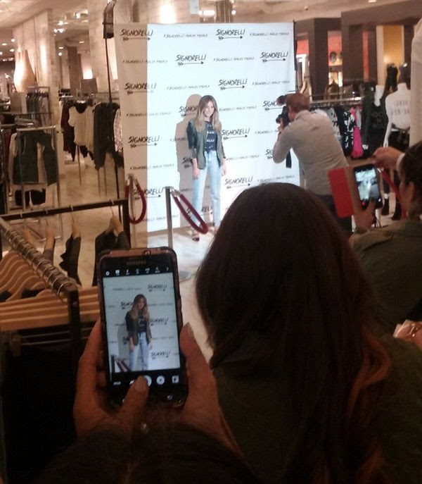 Ashley Tisdale poses for the cameras before doing a meet-and-greet at the Bloomingdale's department store in Santa Monica...on September 10, 2016.