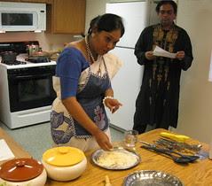 Sangita begins making the dough for the Chapatis