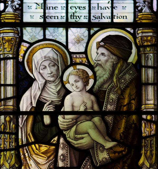 Stained glass window of Anna and the High Priest with Our Lord. Photo taken at St Oswalds Church, Grasmere, England by  john.purvis.