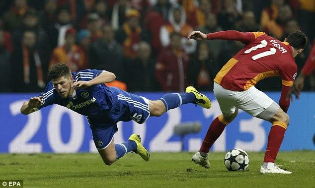 Falling down: Klaas-Jan Huntelaar goes down under the challenge of Albert Riera