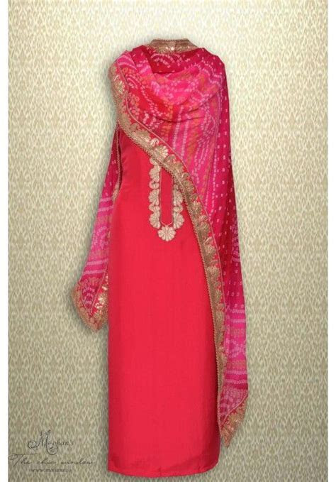 Alluring magenta suit complemented with jaipuri dupatta