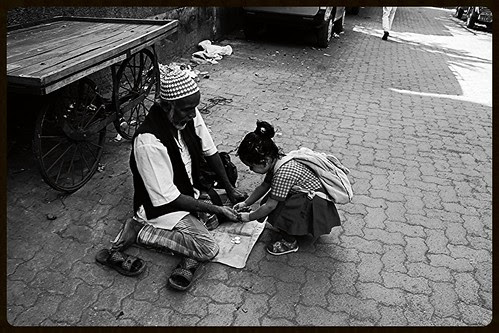 A Childs Healing Touch On The Soul Of A Muslim Beggar by firoze shakir photographerno1