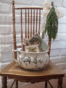 using a vintage chamber pot to put Christmas cards in!