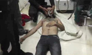 Amateur video provided by the Shams News Network, a loosely organized anti-Assad group, showing a man with an oxygen mask in Kfar Zeita, purportedly the site of a chemical attack.