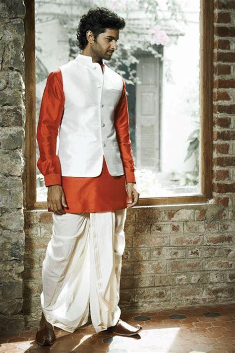 Classic bundi, silk dhoti and kurta by Anita Dongre The