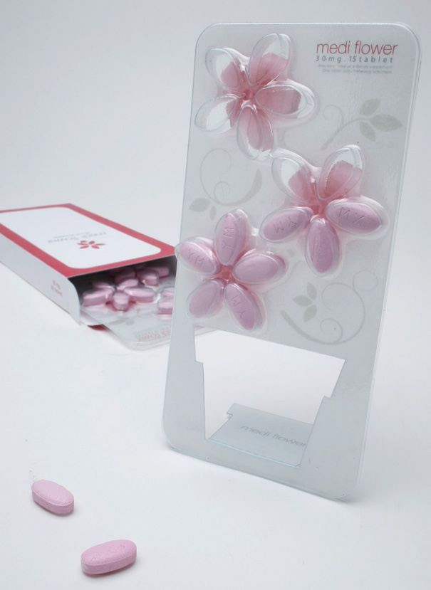 The Medi Flower. It repackages the tablets into cute little stands that you can place at an obvious spot.