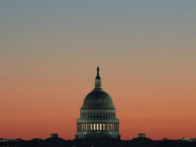 The early morning sun begins to rise behind the U.S. Capitol on November 17, 2016 in Washington, DC. Later today, Vice President-elect Mike Pence is scheduled to meet with Congressional lawmakers on Capitol Hill. (Photo by )