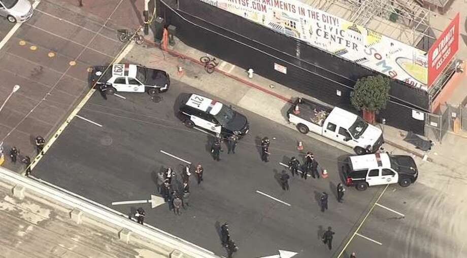 A police officer involved shooting erupted in downtown San Francisco around noon, prompting the closure of Market Street. Photo: CBS San Francisco