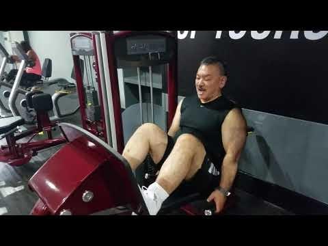 John Mizuno doing leg presses primarily for the Quadriceps and Leg muscles