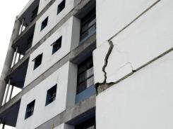 A wall at the University of Costa Rica's school of electrical engineering is damaged after an earthquake in San Jose, Costa Rica, on Wednesday.