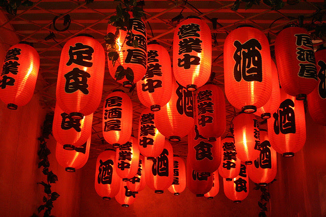 Red lanterns adorn the entrance to the rooftop bar