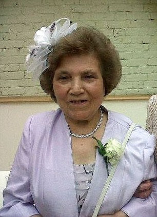 A woman who was found beheaded in a suburban back garden after a man 'went berserk with a machete' has been named by police as Palmira Silva, 82