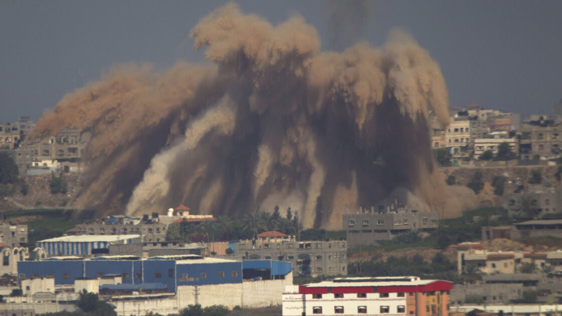 Smoke and debris rise after an Israeli strike on the Gaza Strip Wednesday. Since the Gaza offensive began Tuesday, Israel has attacked more than 400 sites in Gaza.