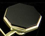 Octagon onyx and gold cufflinks. (J8962)