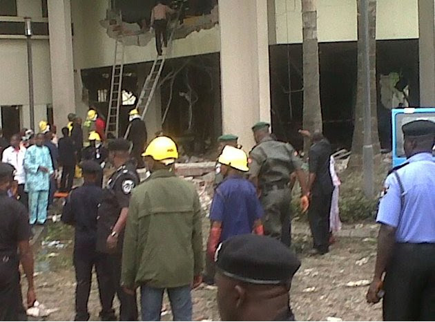 This image released by Saharareporters shows firefighters and rescue workers after a large explosion struck the United Nations' main office in Nigeria's capital Abuja Friday Aug. 26, 2011, flattening