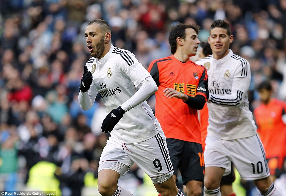 Benzema wheels away in celebration after scoring Real Madrid's third goal as they cruised to victory against Real Sociedad
