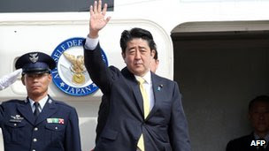 Japanese Prime Minister Shinzo Abe waves as he leaves from Tokyo International Airport for Turkey on a government plane on 28 October, 2013.