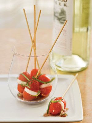 Mini Caprese Bites Ingredients: 1 pt. grape tomatoes, halved 10 to 14 fresh small mozzarella cheese balls, cut into thirds 32 (4-inch) wooden skewers 1/4 cup extra virgin olive oil 2 tablespoons balsamic vinegar 1/4 teaspoon kosher salt 1/4 teaspoon pepper 6 thinly sliced fresh basil leaves Kosher salt and pepper to taste