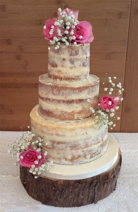 3 tier Semi Naked wedding cake with fresh roses and