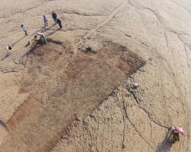 Aerial view of excavation and archaeologists