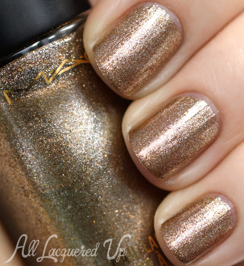 http://www.alllacqueredup.com/wp-content/uploads/2013/12/MAC-Fierce-Entrance-nail-polish-Divine-Night.jpg