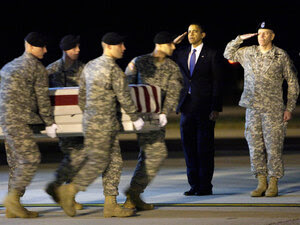 President Obama salutes as an Army team carries the remains of Sgt. Dale Griffin.