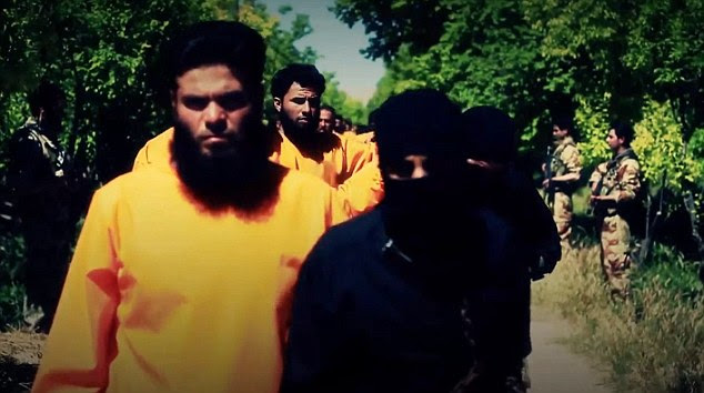 Long walk: Jaysh Al-Islam fighters lead the shackled ISIS soldiers to their deaths in an unknown part of Syria