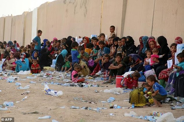 Displaced Iraqi families from Hawijah rest 20 miles from Kirkuk in Iraq after fleeing their homes due to ongoing fighting between government forces and ISIS jihadists, in 2016