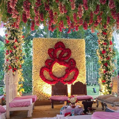 Wedding mandap decorated with lilies roses and traditional
