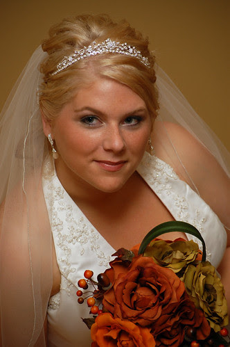 This wedding look has the veil attached to the tiara in back