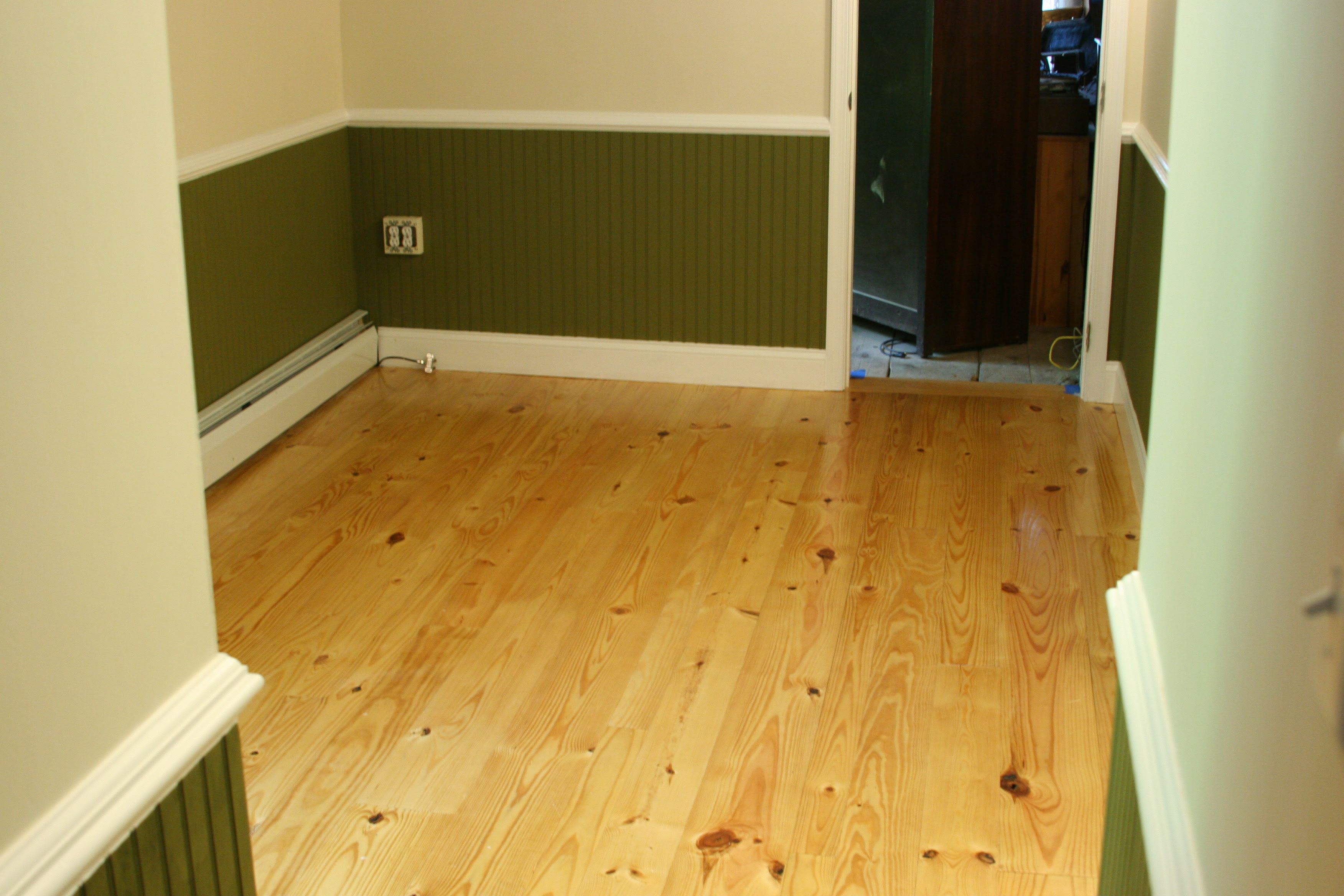 Wood Flooring with Knotty Pine Walls