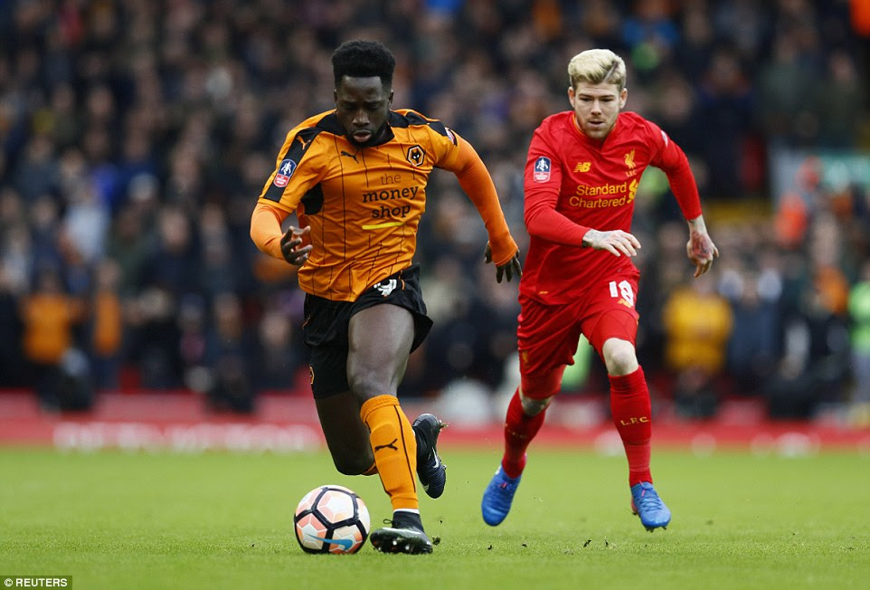 Wolves striker Nohua Dicko sprints forward with the ball away from Liverpool defender Moreno