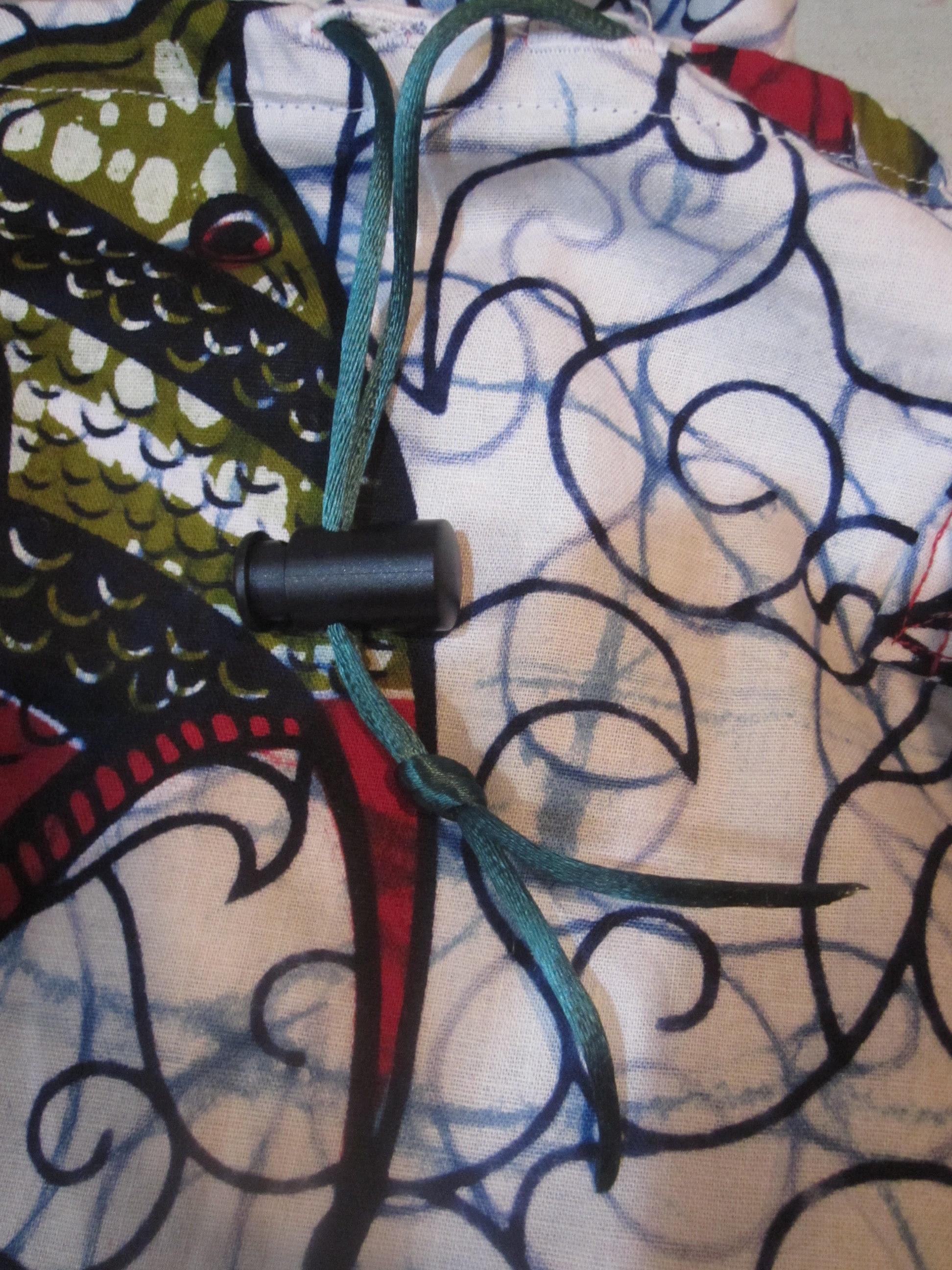 Knot Drawstring Below Cord Stop