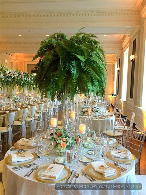 Gorgeous natural fern centerpieces stand majestically at