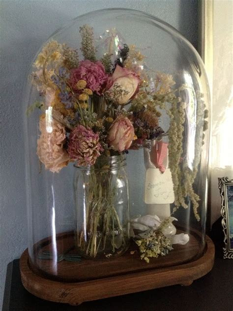 My bridal bouquet, dried and covered with a glass cloche.