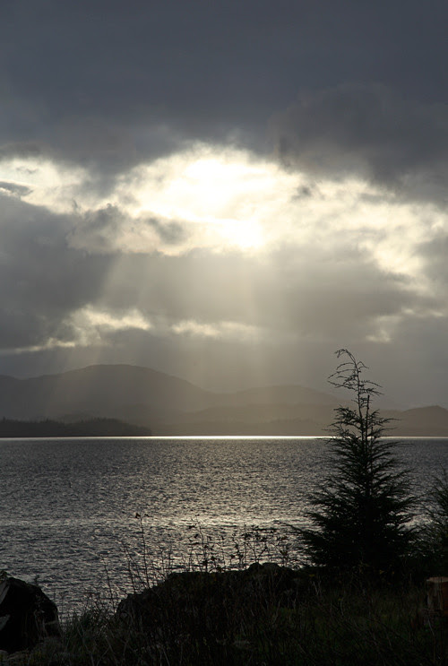 sun rays poke through clouds, Kasaan, Alaska