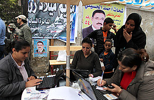 Egyptian Coptic Christians registering people to vote. The Islamist parties have won a large majority in the parliamentary elections. by Pan-African News Wire File Photos