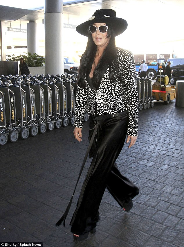 Jet-set chic! Cher looked glamorous as she jet out of LAX on Sunday