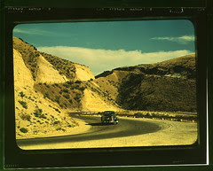 Road cut into the barren hills which lead into...