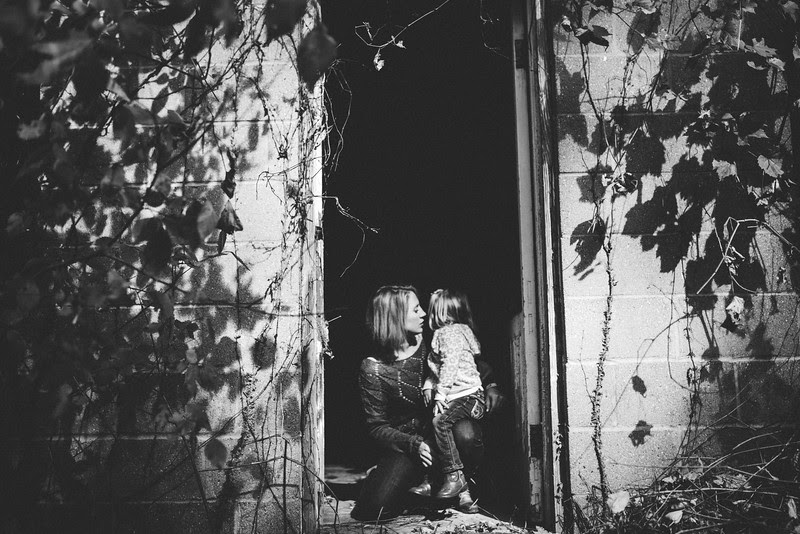A unique outdoor autumn family portrait session in woods, barns, and abandoned property outside of Rockford, IL