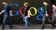 People walk past a logo next to the main entrance of the Google building in Zurich March 9, 2011. REUTERS/Arnd Wiegmann