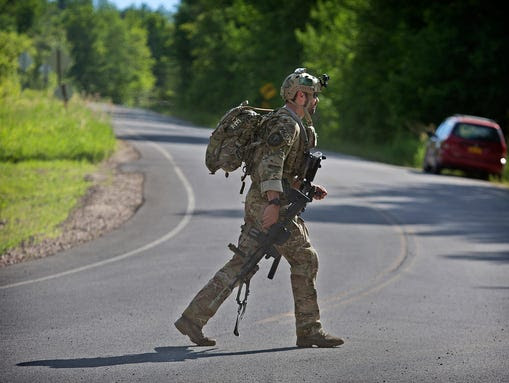 An officer leaves the operations command post at Titus