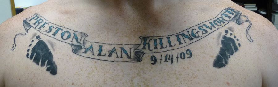 Banner And Memorial Baby Footprints Tattoos On Chest