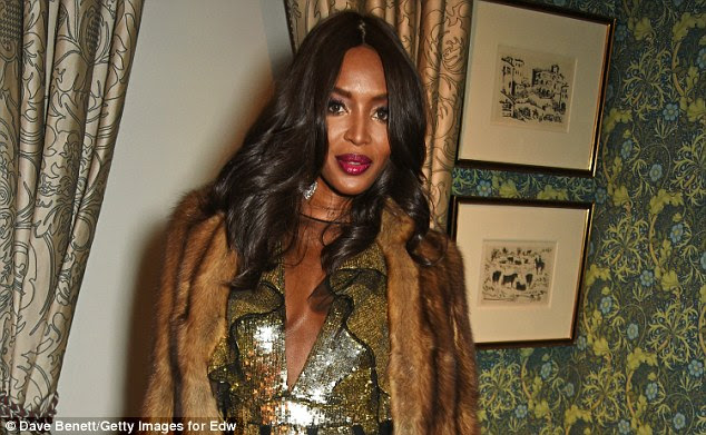 Bold and beautiful:Adding a splash of colour, Naomi opted for a generous application of deep red lipstick, while an equally liberal use of bronzer enhanced her naturally pretty features