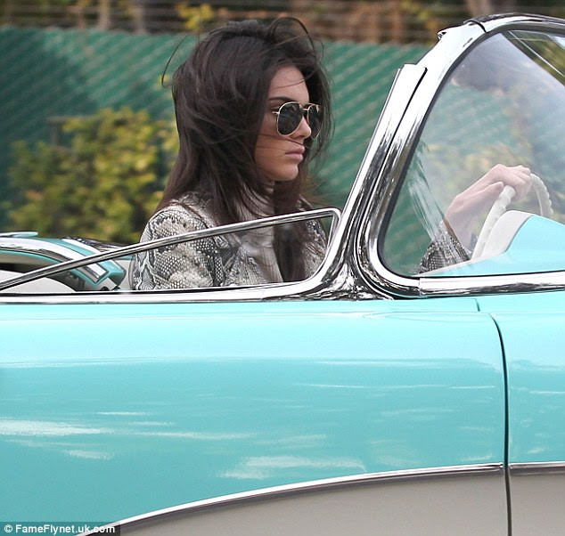 Model looks: Kendall Jenner cruised around on Thursday in a classic Corvette convertible in Beverly Hills, California
