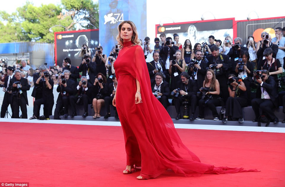 Red hot: Greta Scarano went for a billowy red dress which matched the red carpet