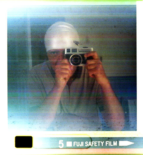 reflected self-portrait with Petri 607 camera and swimming cap by pho-Tony